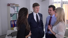 Confident smiling young people staying in the office talking start up business Stock Footage