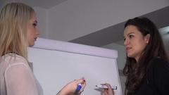 Businesswomen meeting writing on flip chart flipchart female team agreement plan Stock Footage