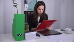 Determined trustful businesswoman job writing meeting schedule in red clipboard Stock Footage