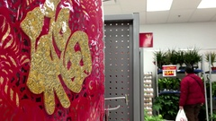 One side of selling Chinese New Year scroll display and shopper walking through Stock Footage