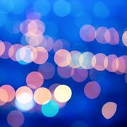 Beautiful city blurring lights abstract circular bokeh blue background, close Kuvituskuvat