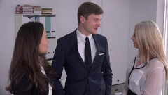 Young handsome executive man hand shake women leaders in office positive people Stock Footage