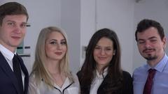 Closeup head young team confident businessmen businesswomen smiling trustful 4K Stock Footage