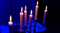 Element of the decor - burning candles in candleholders Stock Footage