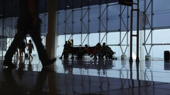 Silhouettes of passengers at Barcelona airport. Timelapse. Stock Footage