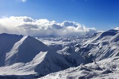 Speed flying in sunny winter mountains Stock Photos