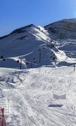 Ski slope and gondola lift at sun winter evening Kuvituskuvat