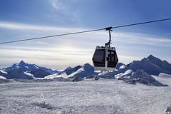 Ski lift in snow winter mountains at evening Kuvituskuvat