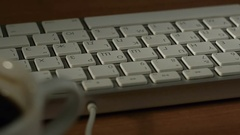 Man at work at the computer enters text using the keyboard Stock Footage