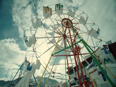Ferris wheel with background white clouds Stock Footage