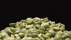 SLOW MOTION: Macro shot of falling of dried green peas on a heap Stock Footage