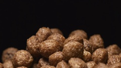 SLOW MOTION: Macro shot of falling of chocolate balls on a heap Stock Footage