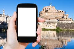 Tourist photographs Holy Angel Castle in Rome Stock Photos