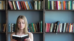 Young woman is reading a literature or learning Stock Footage