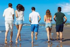Friendship Freedom Beach Summer Holiday Concept - young people running Stock Photos