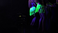 Go-Go Dancers in Green Neon Skirts Dance in Night Club Stock Footage