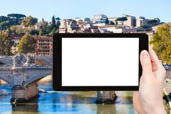 Tourist photographs bridge on Tiber River in Rome Stock Photos