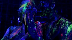 People are colored fluorescent powder. Unreal love in ultraviolet light Stock Footage