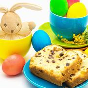 Easter still life with bunny, colored eggs and cakes Stock Photos