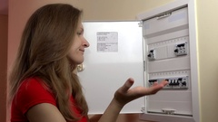 Woman pushing lever in fuse box Stock Footage