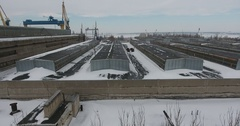 Aerial view large hangars Shipyard on background of river and shipbuilder winter Stock Footage