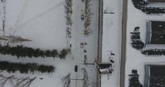 Aerial view on alley with trees and car near old building in winter Stock Footage
