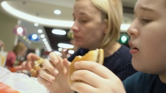 Eating in fast food restaurant Stock Footage