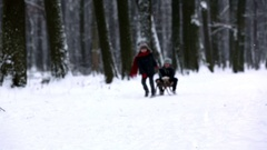 Two Happy little children, boys, playing outdoors in snowy park Stock Footage