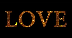 Gold glitter sparkle particles love word shape on black background Stock Footage