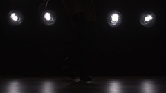 Silhouette of a girl dancing on the background lights. Slow motion Stock Footage