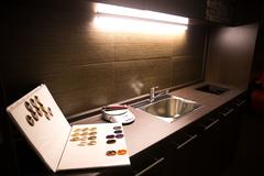 Washbasin utility room in a hair salon with  book example dye colors Stock Photos