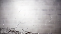 Tomato drop down in water with splashing, slow motion Stock Footage