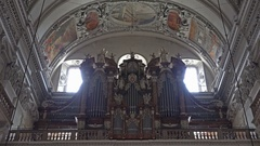4k Entrance indoor shot tilt down church organ catholic Salzburg cathedral Stock Footage