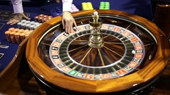 Wooden Roulette table in casino ball Stock Footage
