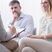 Taking advice at psychiatrist Stock Photos