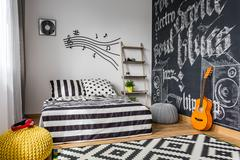 Monochrome bedroom for musician Stock Photos