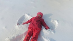 Child portrays an angel in the snow. Stock Footage