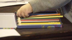 Small girl having fun and drawing with colored pencils at home Stock Footage