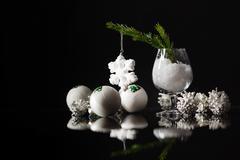 Modern vintage high contrast photo of shiny, bright silver christmas balls .. Stock Photos