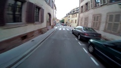 POV of a man biking through the streets of a small European town. Stock Footage