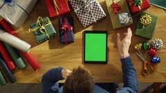 Top View of a Young Man Sitting at His Table Full of Packed Gifts  Stock Footage