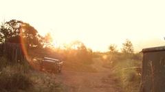 Slow pan over safari camp at sunset Stock Footage