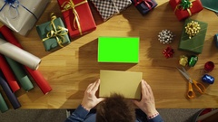 Top View of a Man Closing Beautiful Gift Box. Box Interior is  Green Screen Stock Footage
