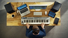 Top View of a Musician Creating Music at His Studio, Playing on a Synthesiser. Stock Footage