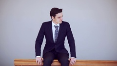 Young businessman is frustrated and upset a strong feeling of hatred. Sitting in Stock Footage