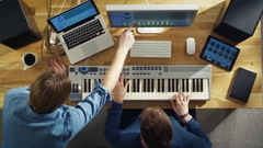 Top View of Two Audio Engineers Working in Their Sunny Studio.  Stock Footage