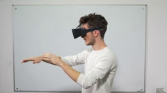 Student trying on VR glasses in classroom a with whiteboard Stock Footage