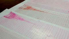 Earthquake wave on a graph paper. Panning Stock Footage