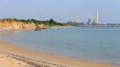 Sai Thong beach and sea with electrical power plant , Rayong, Thailand Stock Footage