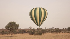 CLOSE UP: Safari hot air balloon flying close above the ground on sunny day Stock Footage